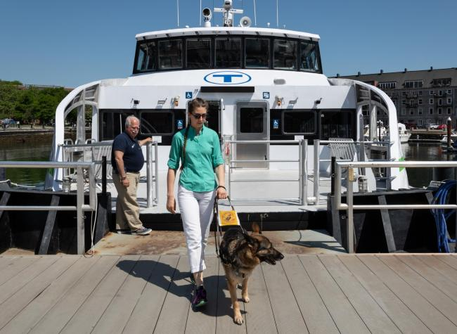 customer exiting mbta ferry with guide dog