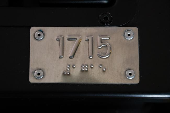 bus number in raised letters and braille