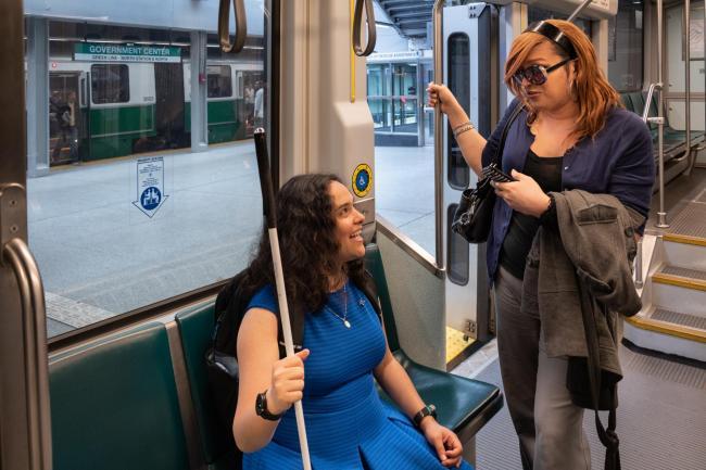 customers in green line priority seats