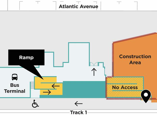 Map showing the ramp in the South Station bus terminal, providing access between Track 1 and Atlantic Ave. See text for details.
