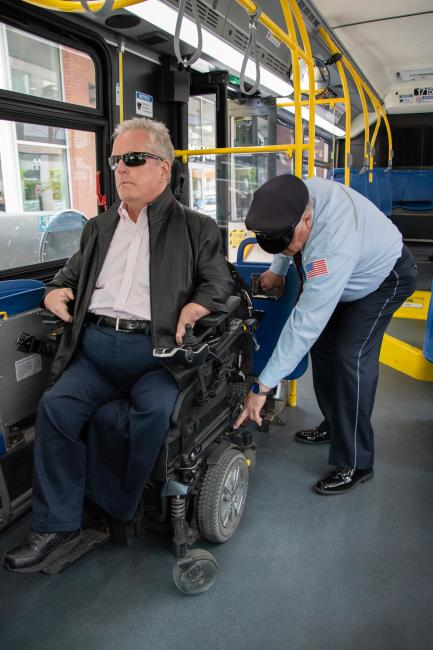 bus operator securing wheeled mobility device