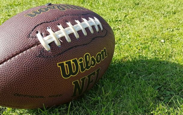 An American football on the grass