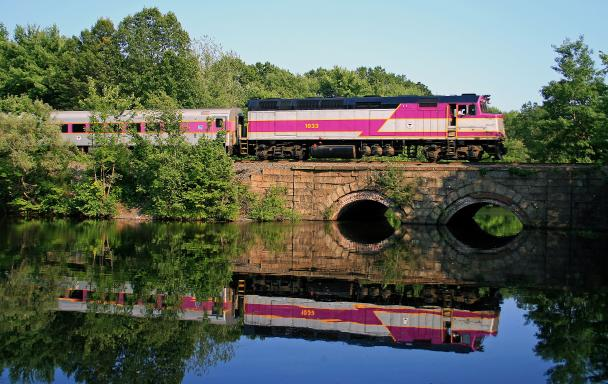 Commuter Rail train crossing a bridge in Ashland