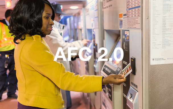 A woman in a yellow coat uses a fare vending machine. White text overlaid: AFC 2.0