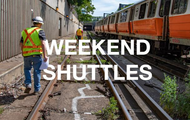 Construction crewmen on Orange Line tracks. Text: Weekend Shuttles