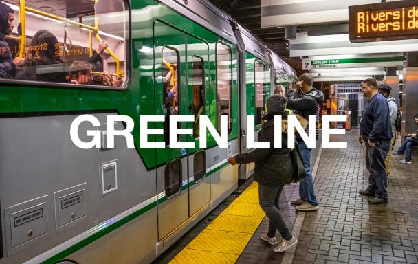 "New Green Line car at Park Street, with riders on the platform getting ready to board. Text overlaid reads ""Green Line."""