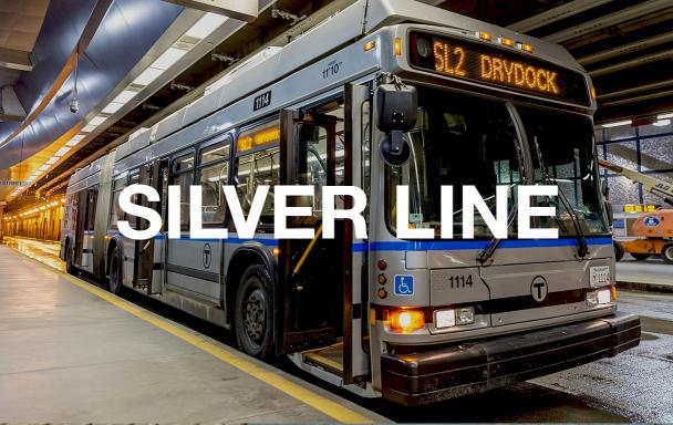 "SL2 bus at World Trade Center Station. Text overlaid reads ""Silver Line."""