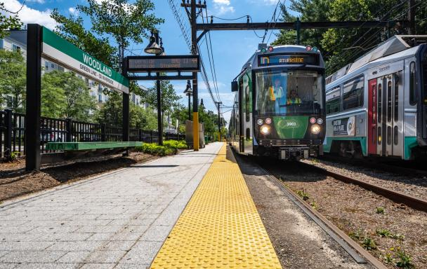 New Green Line Type 9 vehicle pulls up to the Woodland Station platform (July 2019)
