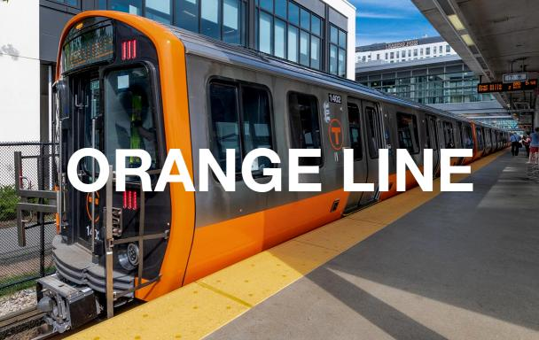 """A new Orange Line train at Assembly Station, with white text overlaid reading """"Orange Line"""""""