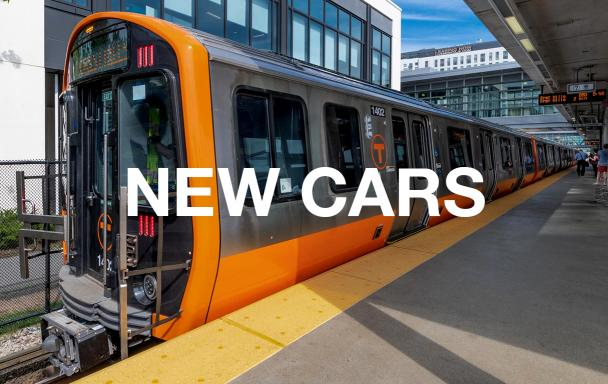 "A new Orange Line train at Assembly Station, with white text overlaid reading ""New Cars"""