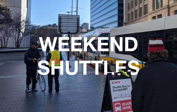 """Bus shuttles replacing Red Line service, outside South Station. White text overlaid says """"Weekend Shuttles."""""""