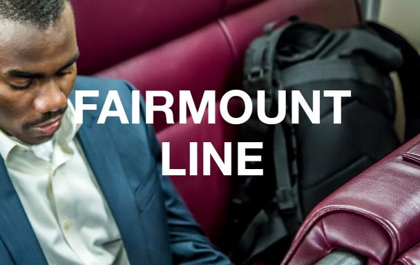 "A man in a suit on the Commuter Rail. Overlaid text reads ""Fairmount Line."""
