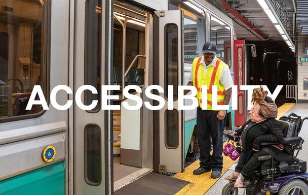 """On the Green Line, an operator stands by the doors, as the bridge plate allows a rider in a wheeled mobility device to board. Text overlaid reads """"Accessibility."""""""