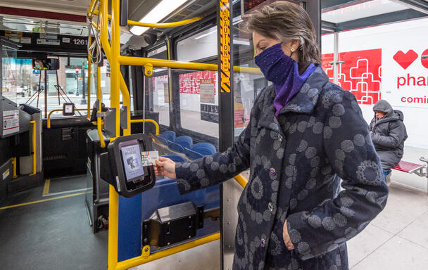 A field demo particpant uses one of the new CharlieCard reader prototypes installed on bus routes 28 and 39