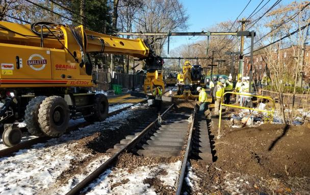 Placing new railroad ties along the D Branch
