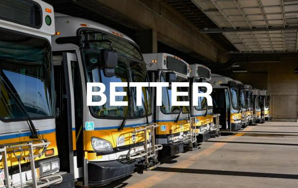 Buses in a garage. Text overlaid: Better.