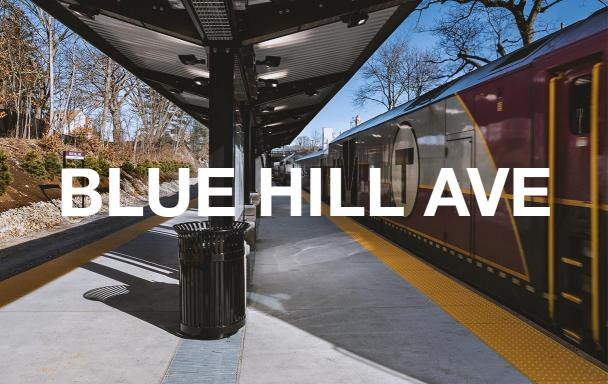 A new Commuter Rail train pulls up the platform at Blue Hill Avenue Station