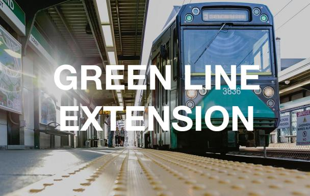 Green Line train pulls into Science Park. Text overlaid: Green Line Extension.