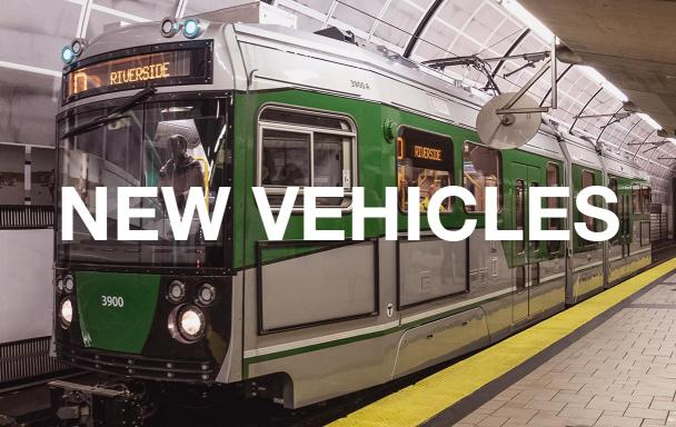 New Green Line car at North Station. Text overlaid: New Vehicles