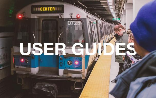 Riders stand on the Blue Line platform as a train pulls into Wonderland Station. Text overlaid: User Guides