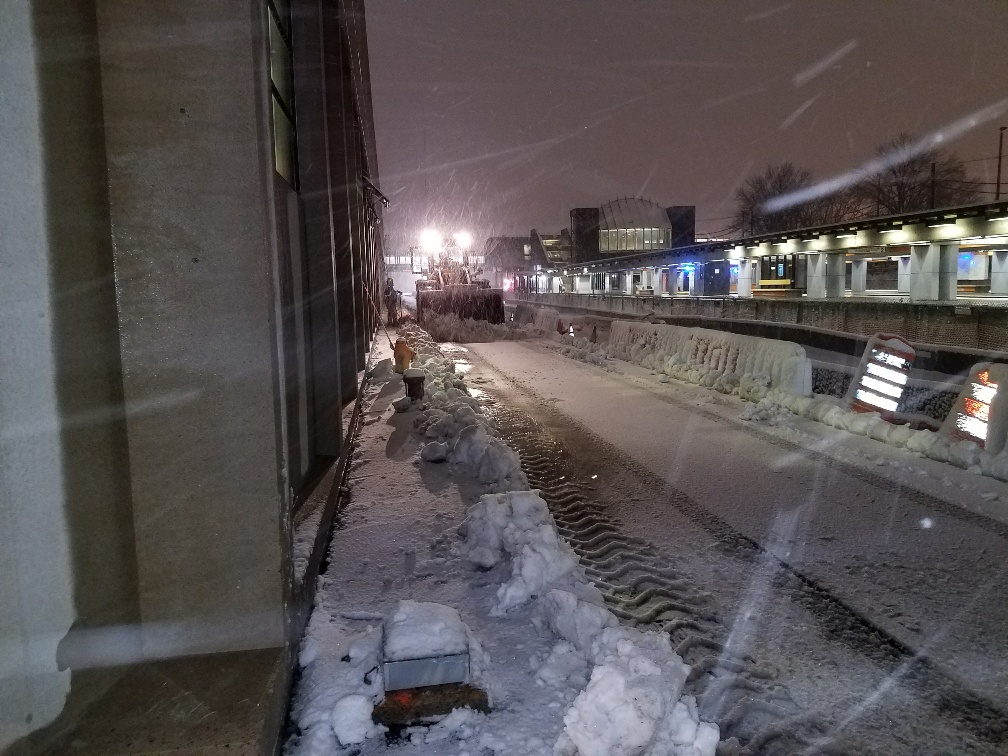 A snow plow clears a path.