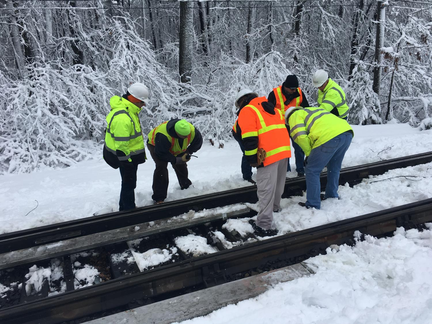 A crew inspects the tracks