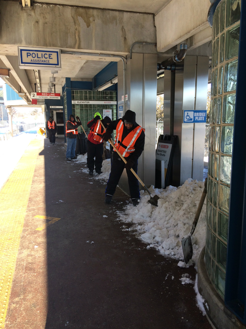 north-quincy-shoveling-crew-orange-vests_0.jpg